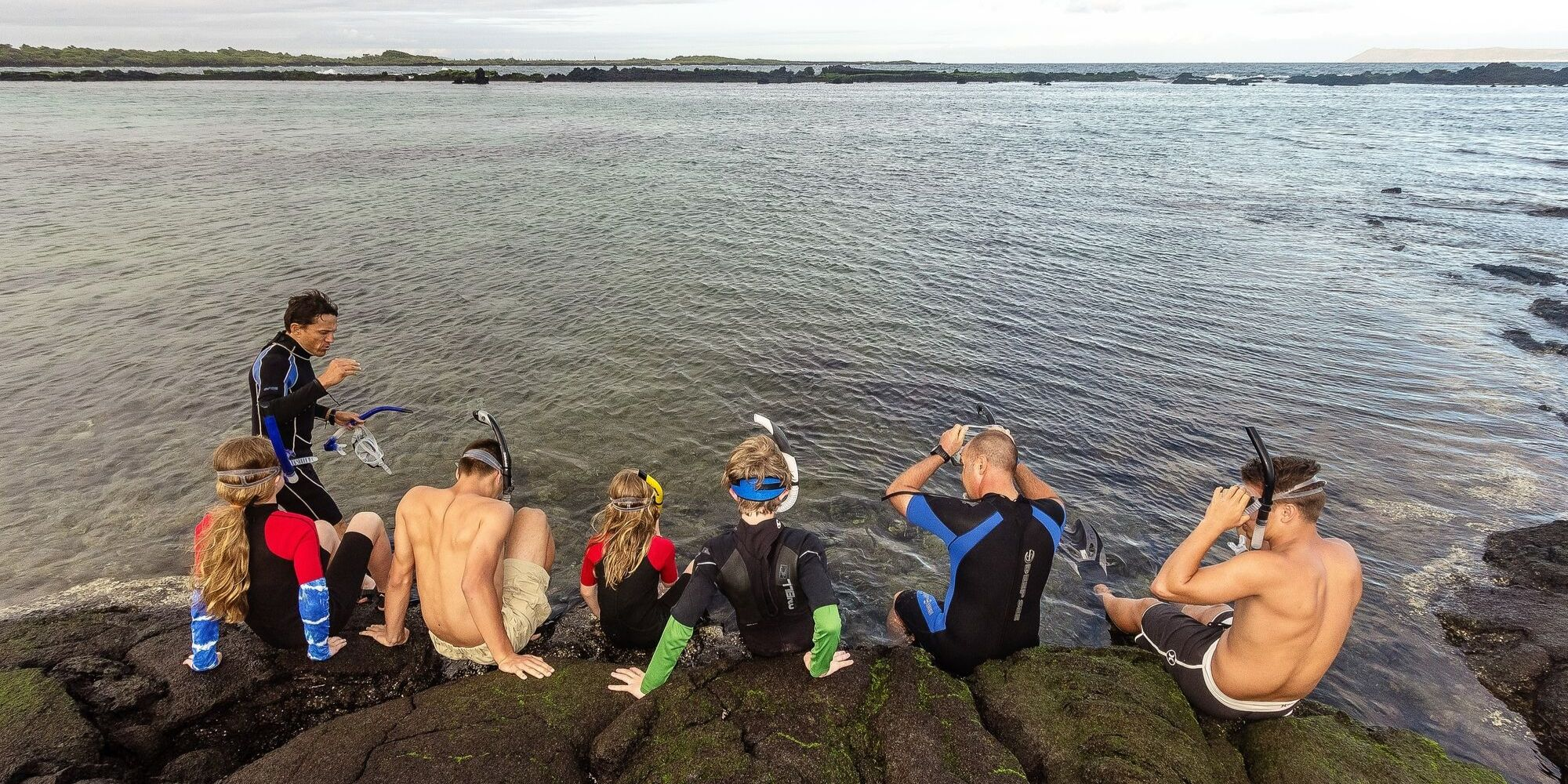 family snorkeling in the Galapagos